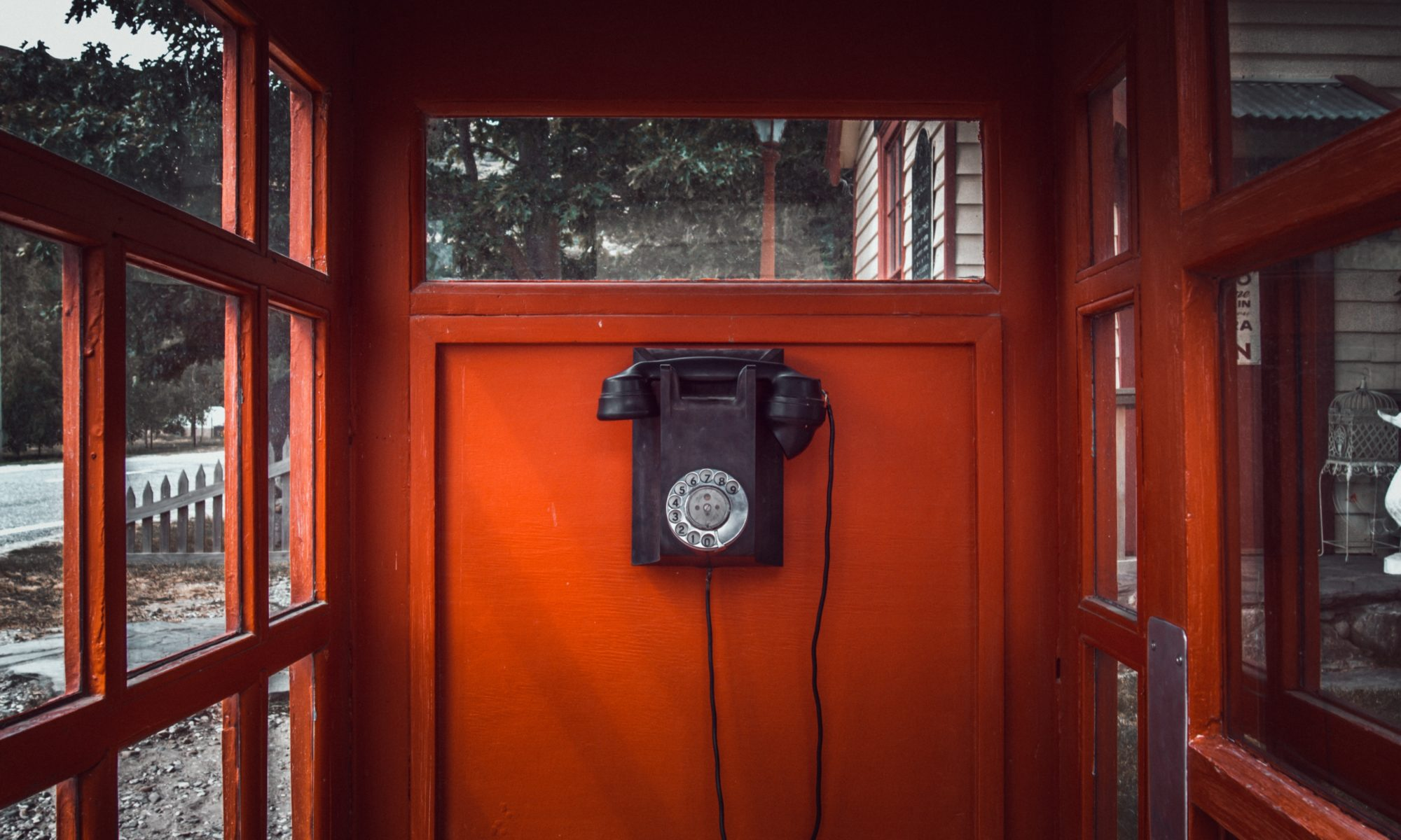 old- fashioned telephone in a red phone box